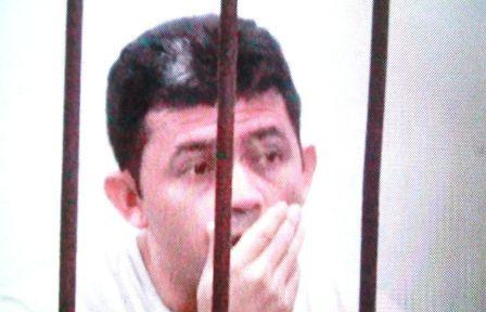 Alessandro em uma das celas do Ciosp. Foto: Olho de Boto