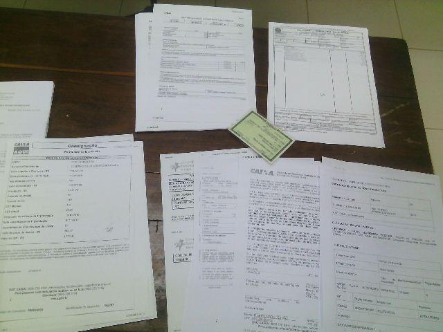 Além de quantia em dinheiro, Polícia Federal flagrou o falso servidor com documento falso. Fotos: Olho de Boto